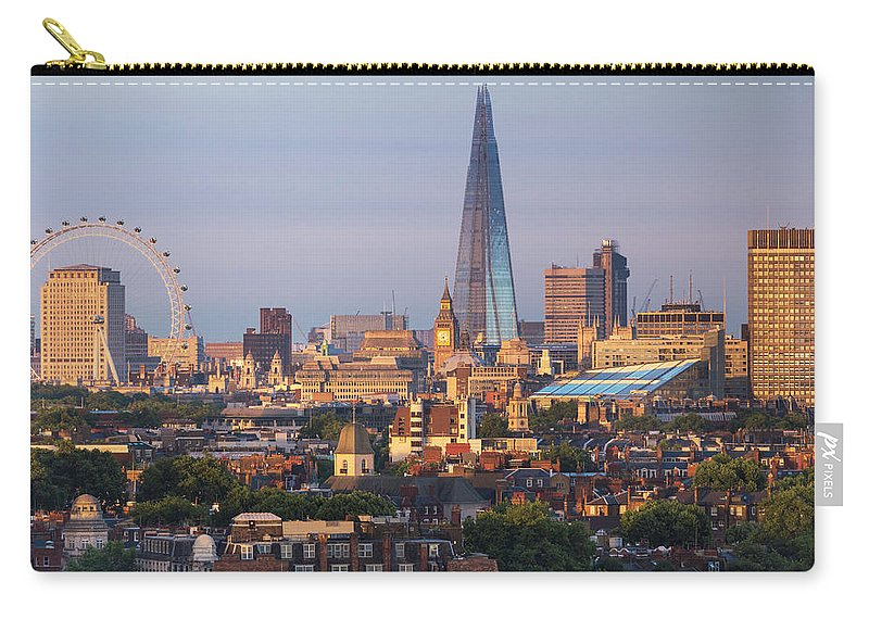 Tranquility Carry-all Pouch featuring the photograph City Skyline In Late Evening Sunlight by Simon Butterworth
