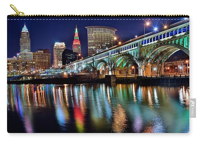 Cleveland Carry-all Pouch featuring the photograph Cleveland Ohio Skyline Reflects Colorfully by Frozen in Time Fine Art Photography