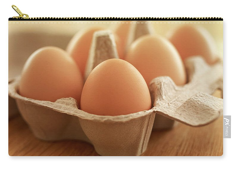 Free Range Carry-all Pouch featuring the photograph Close Up Of Brown Eggs In Carton by Adam Gault