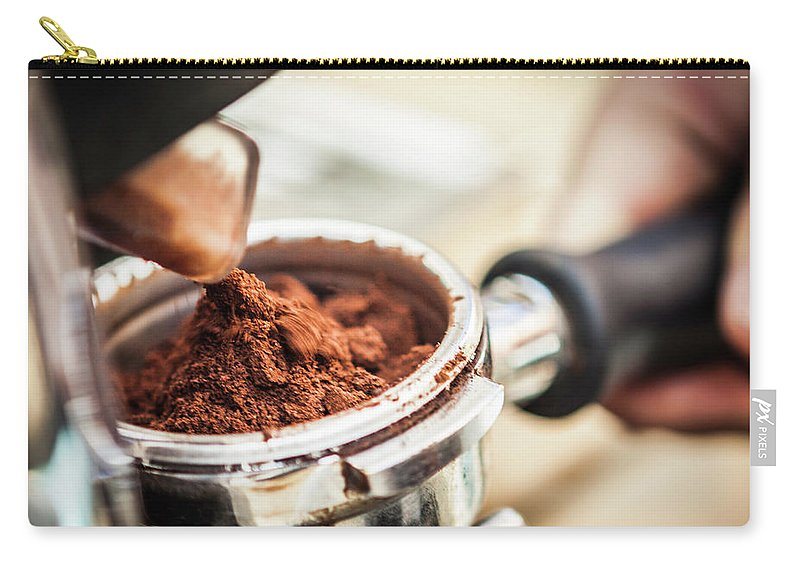 Mature Adult Carry-all Pouch featuring the photograph Close Up Of Espresso Grounds In Machine by Manuel Sulzer