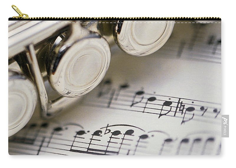 Sheet Music Carry-all Pouch featuring the photograph Close-up Of Flute On Sheet Music by Comstock
