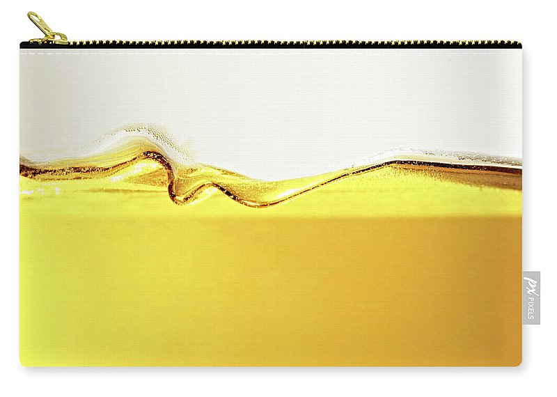 Motion Carry-all Pouch featuring the photograph Close Up Of Oil In Glass by Cwp
