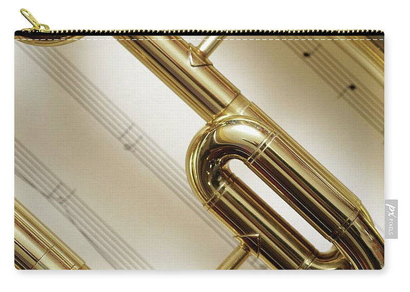 Sheet Music Carry-all Pouch featuring the photograph Close-up Of Trumpet by Medioimages/photodisc