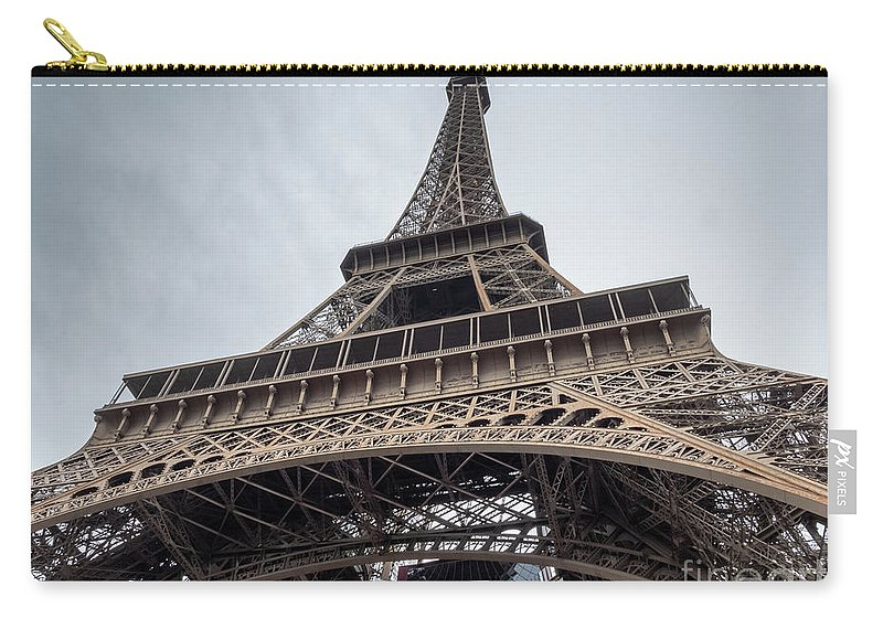 1889 Exposition Carry-all Pouch featuring the photograph Close Up View Of The Eiffel Tower From Underneath by PorqueNo Studios