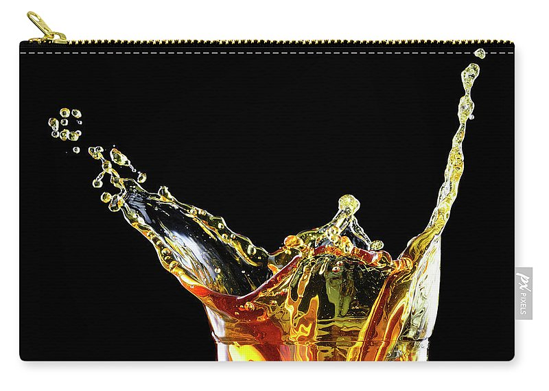 Alcohol Carry-all Pouch featuring the photograph Cocktail With Big Splash In A Tumbler by Chris Stein
