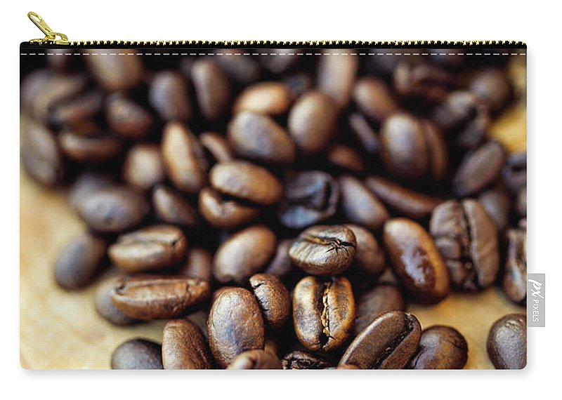 Black Color Carry-all Pouch featuring the photograph Coffee Beans by Chang
