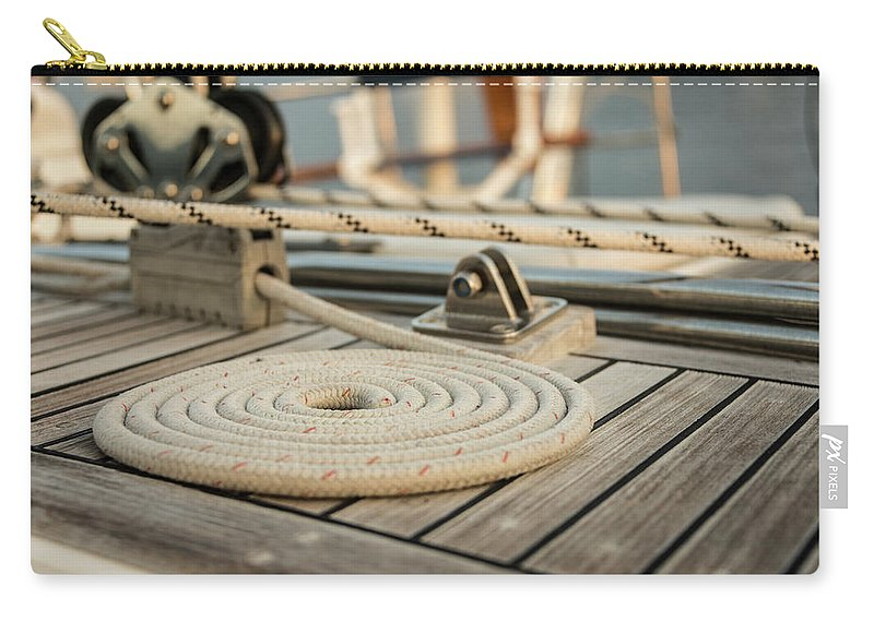 Sailboat Carry-all Pouch featuring the photograph Coiled Line, Rope, On Teak Deck Of 62 by Gary S Chapman