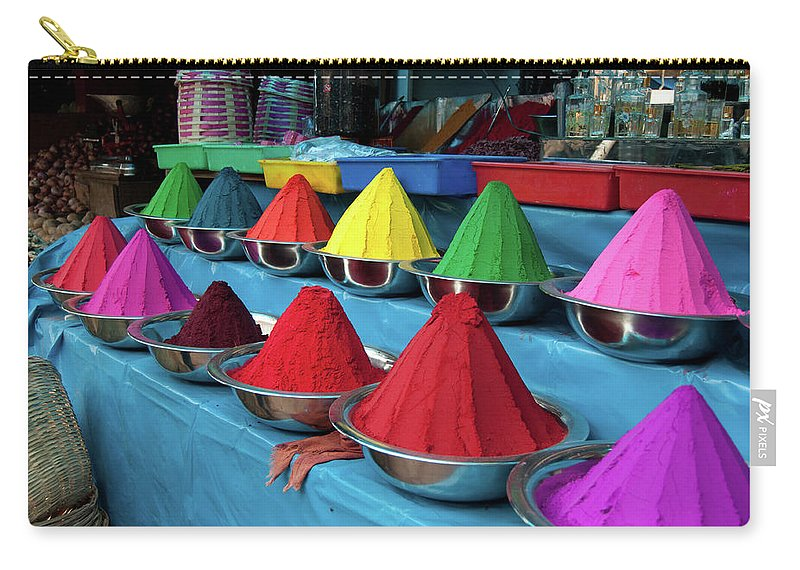 In A Row Carry-all Pouch featuring the photograph Colorful Dyes At Indian Market by Photo By Meredith Narrowe