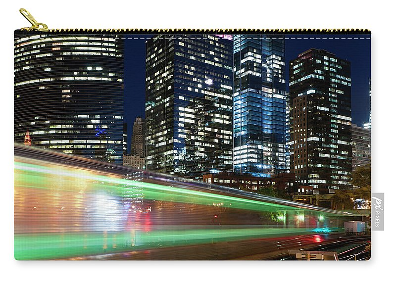 Passenger Train Carry-all Pouch featuring the photograph Commuter Train In Downtown Chicago by Chrisp0