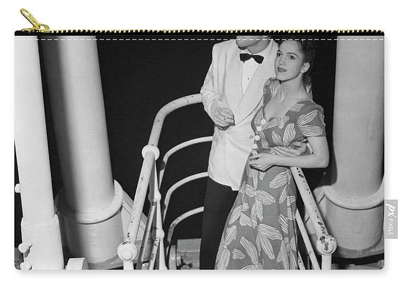 Heterosexual Couple Carry-all Pouch featuring the photograph Couple In Evening Wear by George Marks