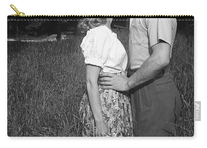 Heterosexual Couple Carry-all Pouch featuring the photograph Couple Kissing Outdoors by George Marks