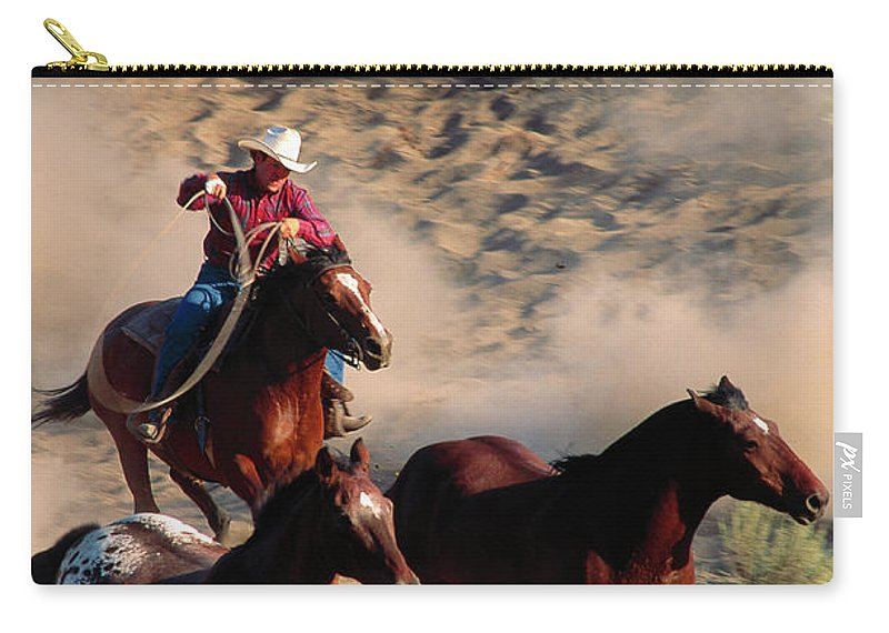 Horse Carry-all Pouch featuring the photograph Cowboy Roping Horses by John Luke