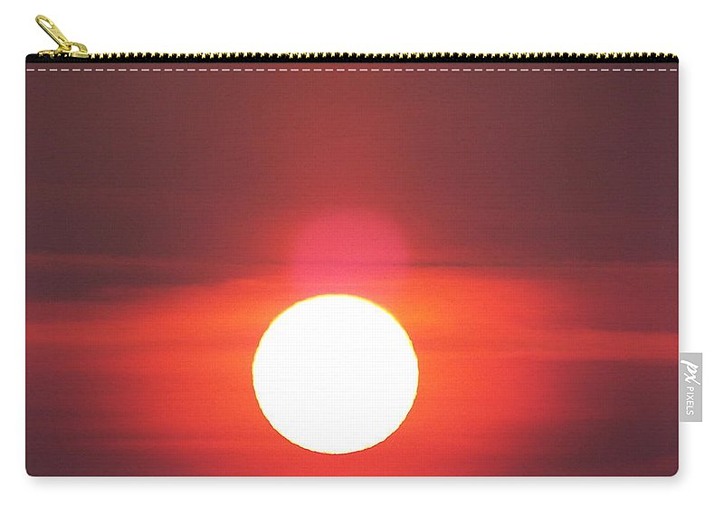 Carry-all Pouch featuring the photograph Crimson Sun by James Harris
