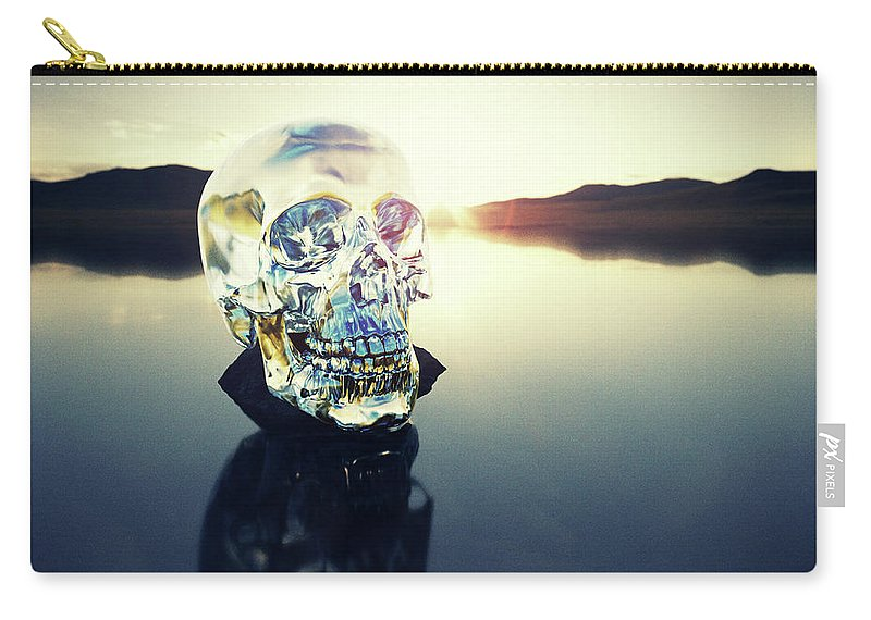 Art Carry-all Pouch featuring the photograph Crystal Skull Laying On Rock In Lake by Doug Armand