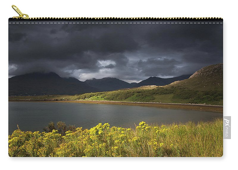 Tranquility Carry-all Pouch featuring the photograph Dark Storm Clouds Hang Over The by John Short / Design Pics