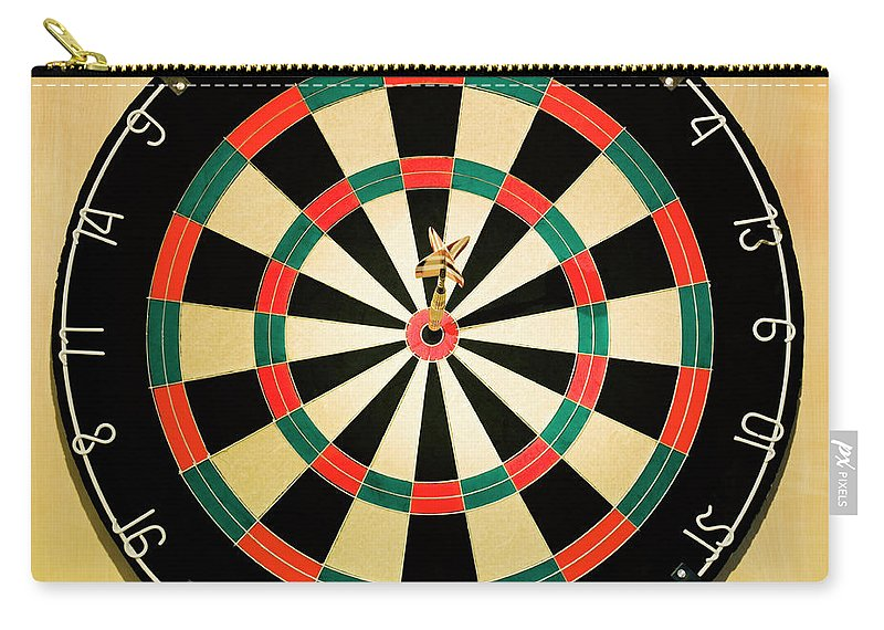Expertise Carry-all Pouch featuring the photograph Dart In Bulls Eye On Dart Board by Fuse