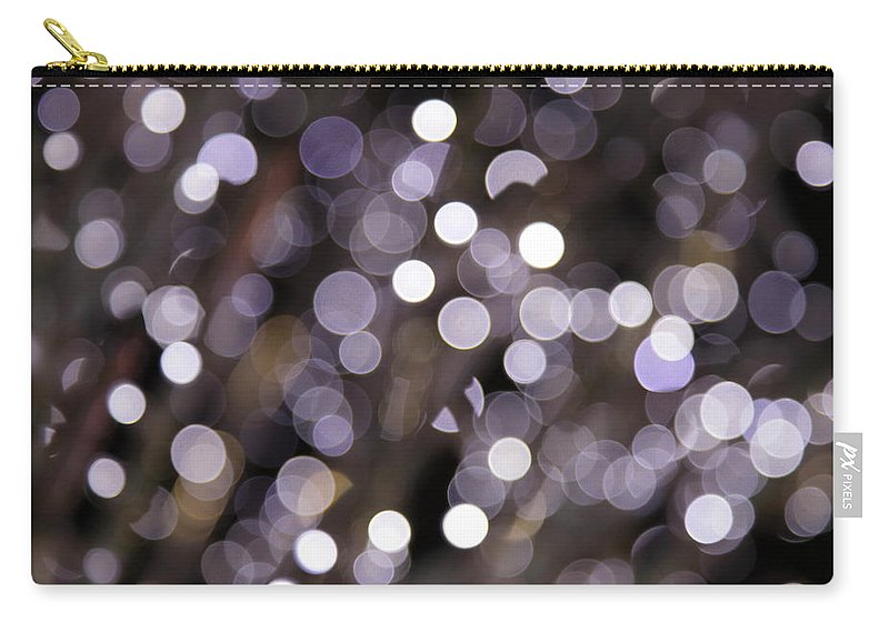 Funky Carry-all Pouch featuring the photograph Defocused Purple Light Dots by Sebastian-julian