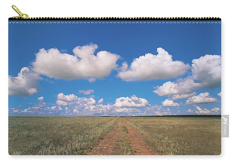 Grainy Carry-all Pouch featuring the photograph Dirt Road On Prairie With Cumulus Sky by Mimotito