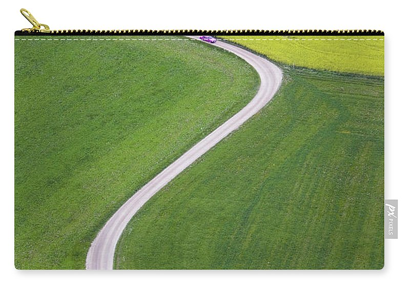 Scenics Carry-all Pouch featuring the photograph Dirt Track Across Farmland, Aerial View by Roine Magnusson