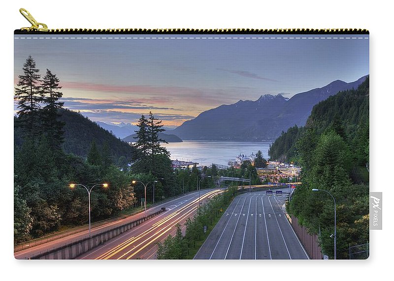 Disembarking Carry-all Pouch featuring the photograph Disembarking by Shaadi Faris