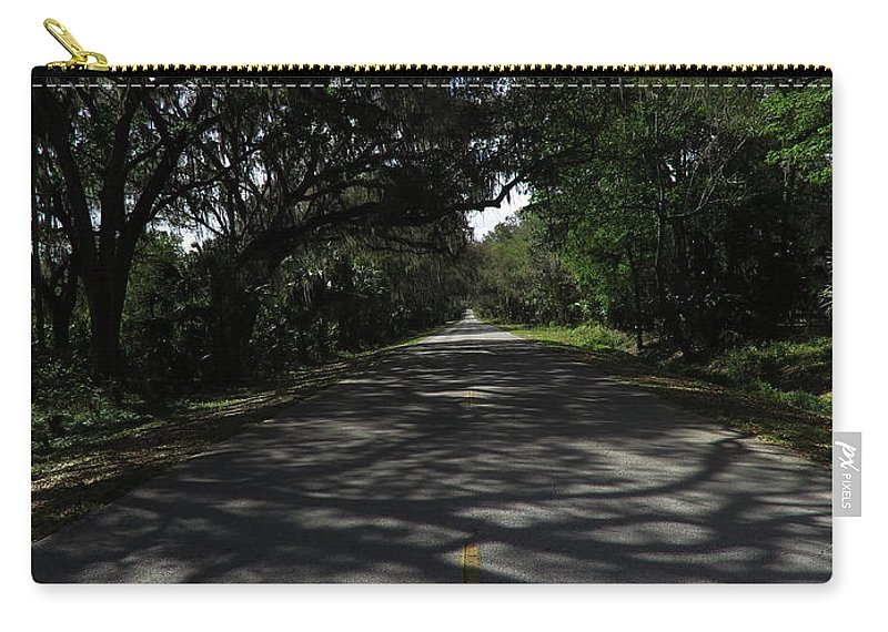 Roads Carry-all Pouch featuring the photograph Dixie Highway In Micanopy Florida by Roger Epps