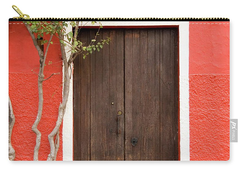 Built Structure Carry-all Pouch featuring the photograph Doorway by Livingimages