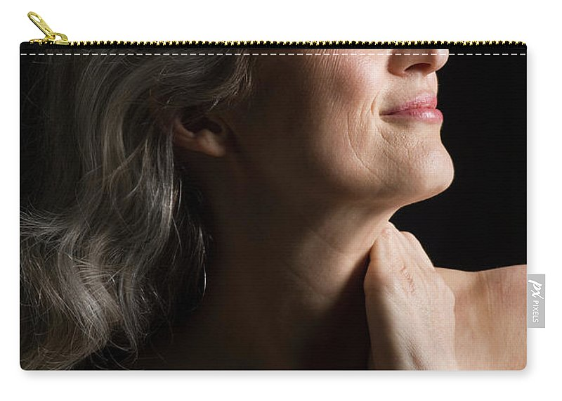 Mature Adult Carry-all Pouch featuring the photograph Dramatic Portrait Of Mid-aged Woman by Leland Bobbe