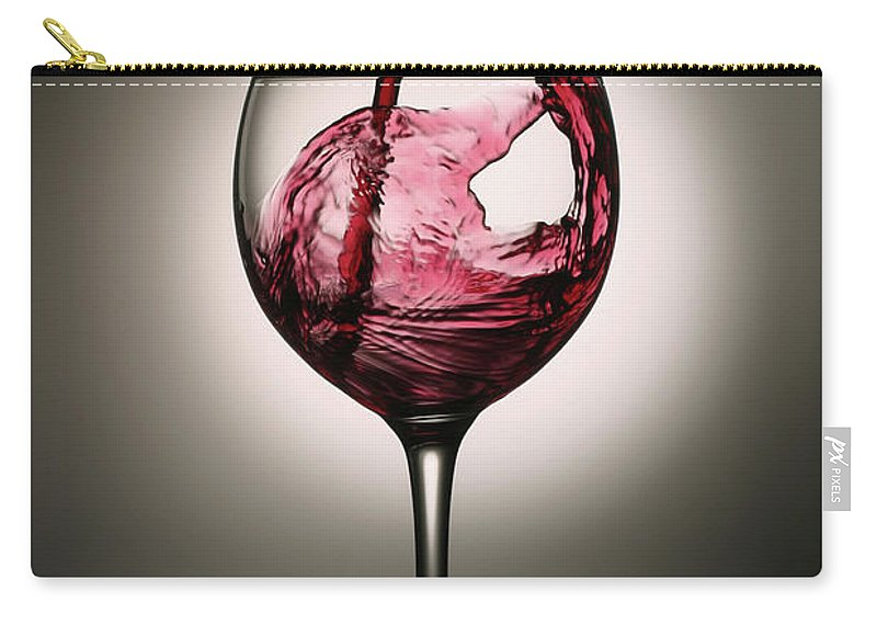 Alcohol Carry-all Pouch featuring the photograph Dramatic Red Wine Splash Into Wine Glass by Donald gruener