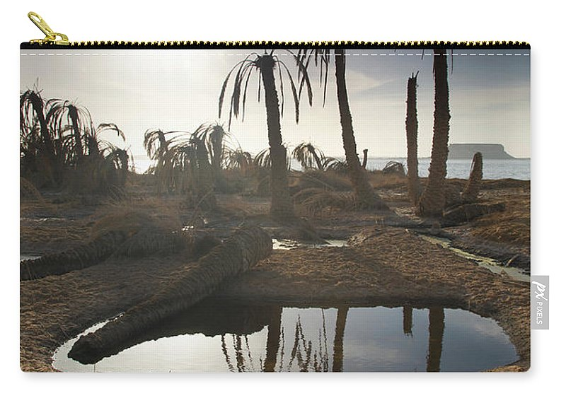 Scenics Carry-all Pouch featuring the photograph Dried Up Palm Trees And Salt Water On by Sean White / Design Pics