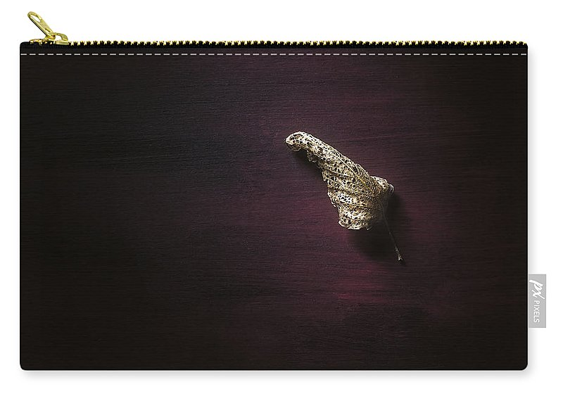 Leaf Carry-all Pouch featuring the photograph Dry Leaf On Muted Red by Scott Norris