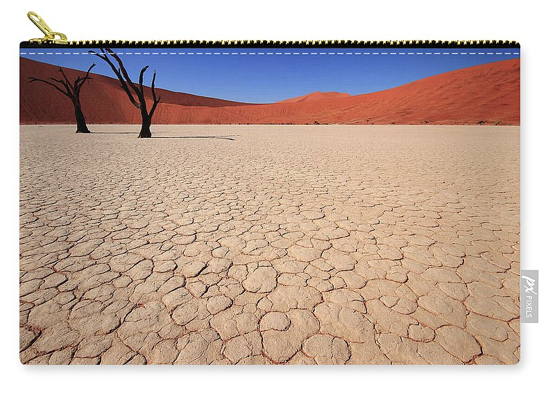 Scenics Carry-all Pouch featuring the photograph Dry Pan Of Deadvlei Plus Two Dead Trees by Klaus Brandstaetter