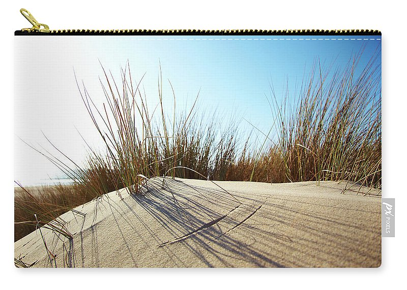 Tranquility Carry-all Pouch featuring the photograph Dune Grass On A Sand Dune At The Beach by Thomas Northcut