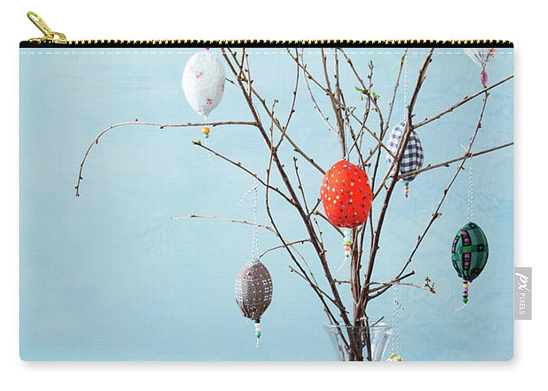 Holiday Carry-all Pouch featuring the photograph Egg-shaped Decorations On Branches by Stefanie Grewel