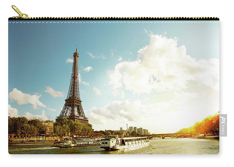 Arch Carry-all Pouch featuring the photograph Eiffel Tower And The River Seine by Vintagerobot