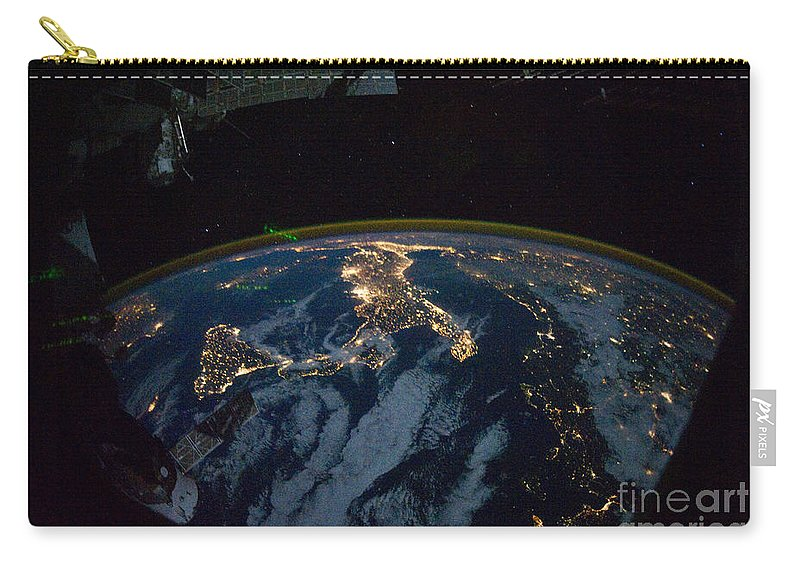 2010 Carry-all Pouch featuring the photograph Italy From Space At Night by NASA Johnson Space Center