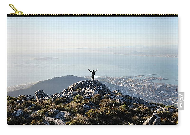 Scenics Carry-all Pouch featuring the photograph Exuberant Man On Top Of Table Mountain by David Malan