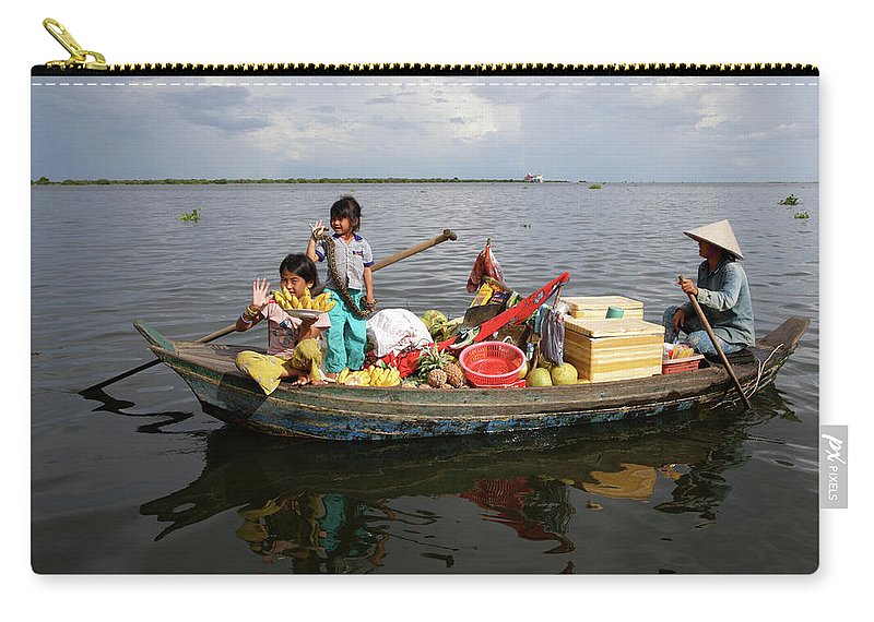 Child Carry-all Pouch featuring the photograph Family & Snake Sell Wares On Tonle by Rosemary Calvert