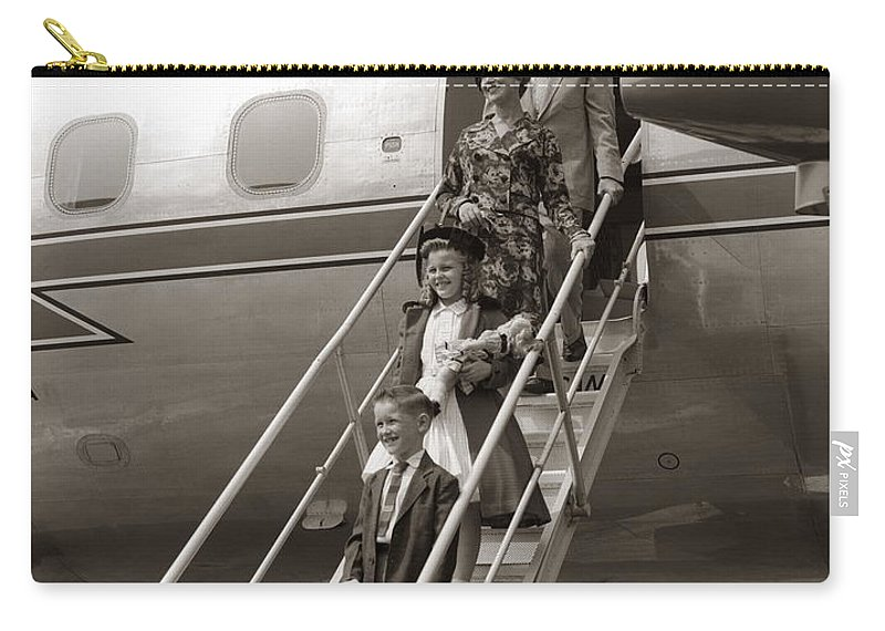 Steps Carry-all Pouch featuring the photograph Family Walking Down Airplane Stairs by H. Armstrong Roberts