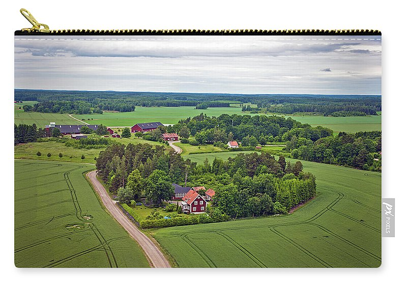 Scenics Carry-all Pouch featuring the photograph Farms And Fields In Sweden North Europe by Pavliha