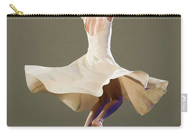 Ballet Dancer Carry-all Pouch featuring the photograph Female Ballet Dancer Dancing by Erik Isakson