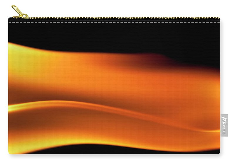 Orange Color Carry-all Pouch featuring the photograph Fire Burning, Flames On Black Background by Tttuna