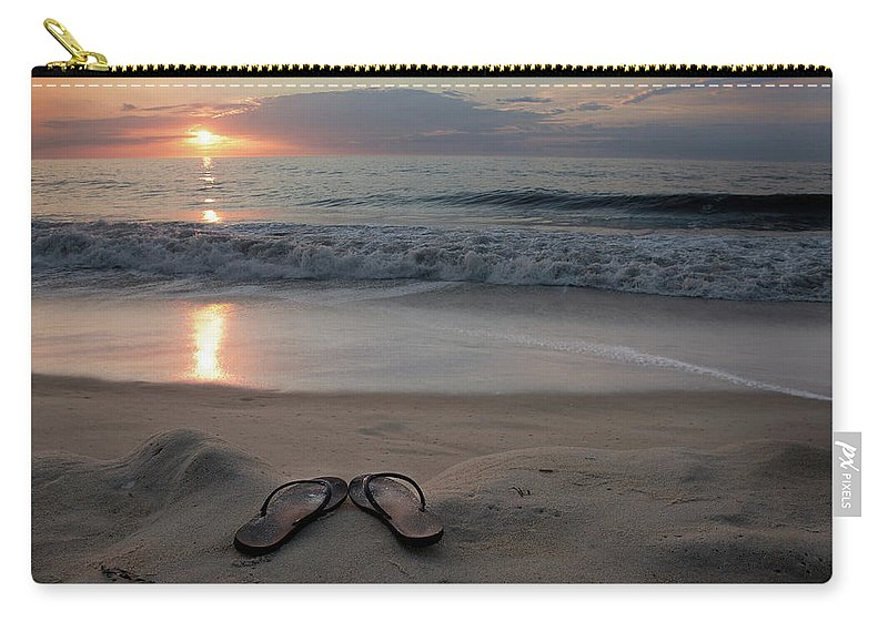Water's Edge Carry-all Pouch featuring the photograph Flip-flops On The Beach by Sdominick