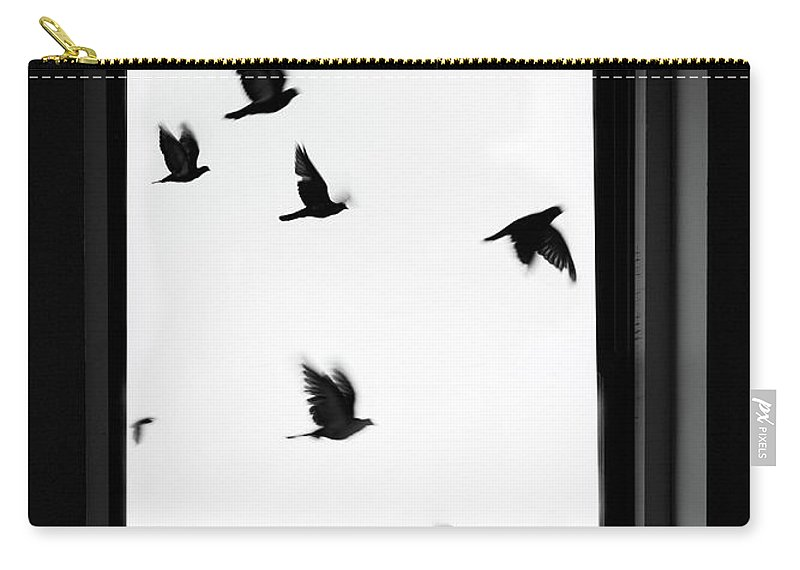 Spooky Carry-all Pouch featuring the photograph Flock Of Crows Seen Through A Window by Grant Faint