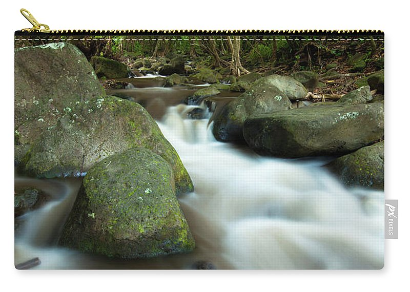 Scenics Carry-all Pouch featuring the photograph Flowing Cascade In Rain Forest Of by Ingmar Wesemann