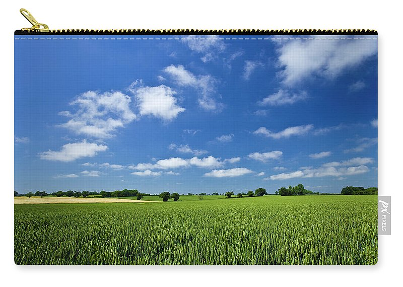 Environmental Conservation Carry-all Pouch featuring the photograph Fresh Air. Blue Skies Over Green Wheat by Alvinburrows