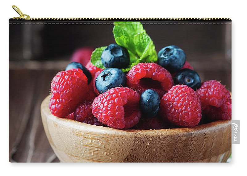 Vitamin Carry-all Pouch featuring the photograph Fresh Sweet Raspberry And Bluberry by Oxana Denezhkina