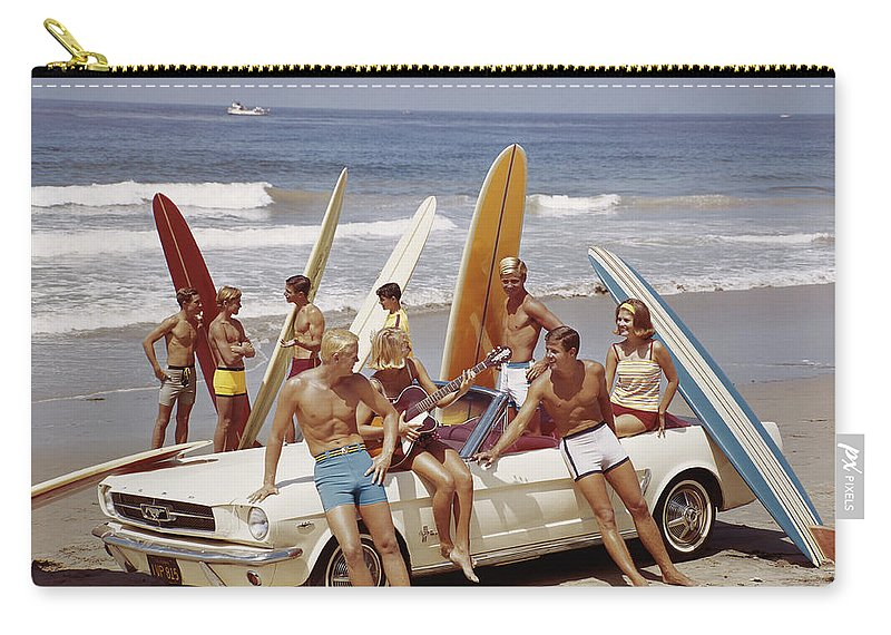 Young Men Carry-all Pouch featuring the photograph Friends Having Fun On Beach by Tom Kelley Archive