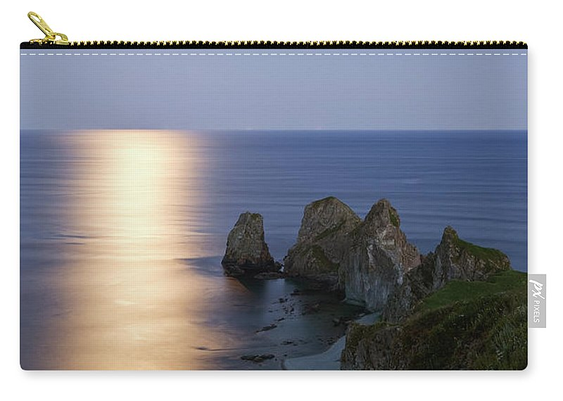 Scenics Carry-all Pouch featuring the photograph Full Moon On Cape Four Rocks by V. Serebryanskiy