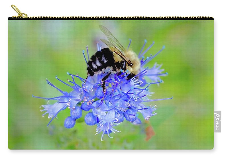 Heavenly Flower Carry-all Pouch featuring the photograph Floating On Blue by Alida M Haslett
