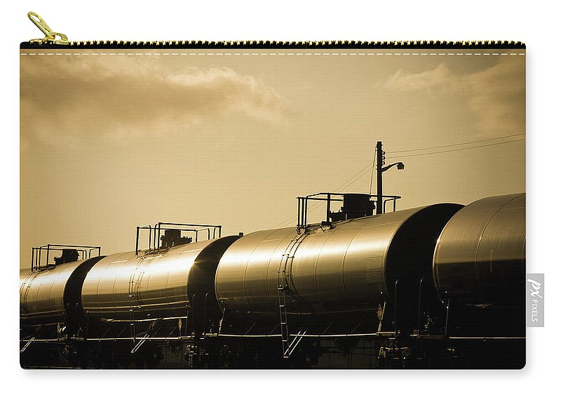 Natural Gas Carry-all Pouch featuring the photograph Gasoline Train At Sunset by Halbergman